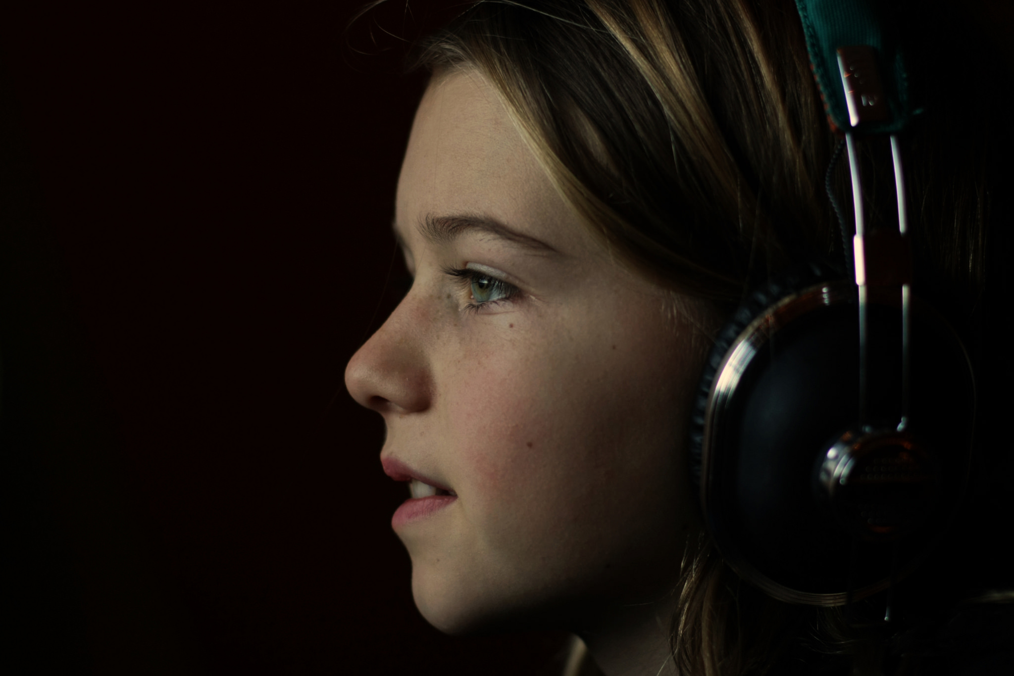 profile of girl listening to headphones