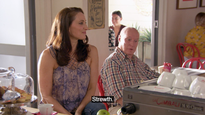 "Screenshot from Home and Away showing Roo Stewart (Georgie Parker) and Alf Stewart (Ray Meagher) looking surprised. The caption ""strewth"" indicates that Alf has just dropped one of his famous catch phrases."